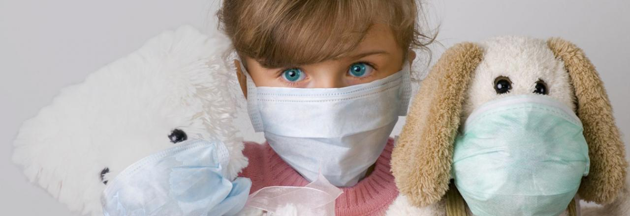 Little Girl and Stuffed Animals Wearing Air Quality Mask